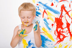 Portrait of a little messy kid painter. School. Preschool. Education. Creativity. Studio portrait over white background Royalty Free Stock Images