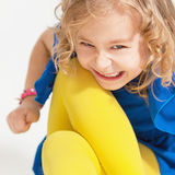 Portrait of a little naughty girl. Stock Photos
