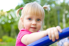 Portrait of little one-year-old girl at a playground in the summ Royalty Free Stock Photos