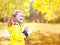 Portrait little positive child having fun outdoors in autumn Royalty Free Stock Image