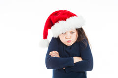 Portrait of a little pouting Christmas girl. Cute Christmas Girl looking grumpy. She is wearing a dark blue sweatshirt Royalty Free Stock Photos