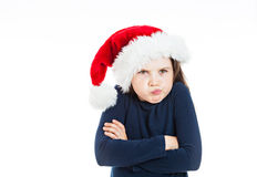 Portrait of a little pouting Christmas girl. Cute Christmas Girl looking grumpy. She is wearing a dark blue sweatshirt Royalty Free Stock Photography