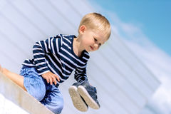 Portrait of little preschool boy outdoors angled Royalty Free Stock Images