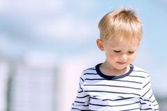 Portrait of little preschool boy outdoors copy space Stock Image