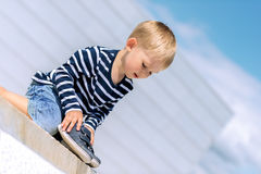 Portrait of little preschool boy outdoors with shoes Stock Image