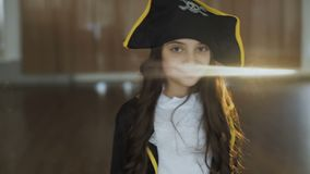 Little girl in costume of pirate posing at camera. Portrait of little pretty girl in costume of pirate posing at camera. Full HD stock footage