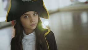 Little girl in costume of pirate posing at camera. Portrait of little pretty girl in costume of pirate posing at camera. Full HD stock video