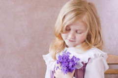 Portrait of little pretty girl with flowers Stock Photo