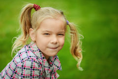 Portrait of little pretty girl playing at summer green park Royalty Free Stock Photo