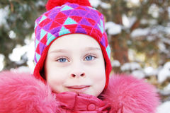 Portrait of a little pretty girl wearing pink clothes outdoor in winter Stock Photos