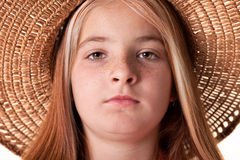 Portrait of little red-haired girl with freckles and a straw hat Stock Images