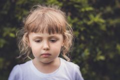 Portrait of a little sad Caucasian girl royalty free stock image