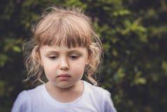 Portrait of a little sad Caucasian girl royalty free stock image