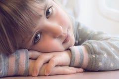 Portrait of a little sad Caucasian girl stock photos
