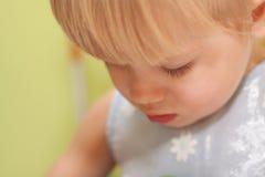 Portrait of little sad girl. Looking down Stock Photo