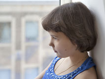 Portrait of a little sad girl. In profile Royalty Free Stock Image