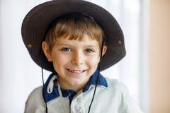 Portrait of little school kid boy wearing cowboy hat Stock Photography