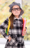 Portrait of a little schoolgirl with books. Portrait of a cute little schoolgirl with books Royalty Free Stock Images