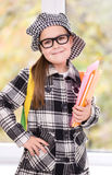 Portrait of a little schoolgirl with books Royalty Free Stock Photo
