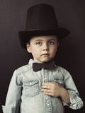 Portrait of a little serious gentleman Stock Images