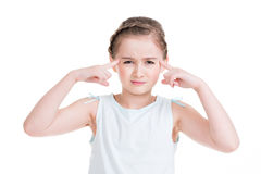 Portrait of a little serious thinking girl. Royalty Free Stock Images