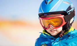 Little skier in safety helmet and goggles. Portrait of little skier in safety helmet and goggles Royalty Free Stock Images