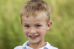 Portrait of a little smiling boy with golden blonde straw hair i Stock Image