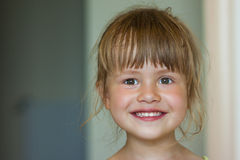 Portrait of a little smiling girl on blurred background royalty free stock photos