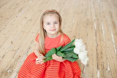 Portrait of little smiling girl child in colorful dress royalty free stock image