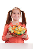 Portrait of little smiling girl with Easter eggs basket Stock Image