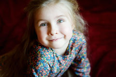 Portrait of a little smiling girl. At home Stock Photos
