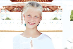 Portrait of a little smiling girl resting on summer vacation Stock Photography