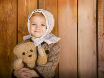 Portrait of the little smiling girl wering vintage clothes with Stock Photos
