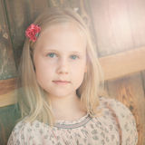 Portrait of little sunny blonde girl Royalty Free Stock Photo