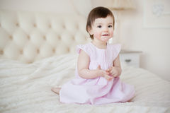 Portrait of a little sweet girl at home Stock Photos