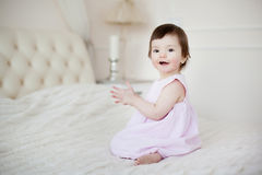 Portrait of a little sweet girl at home Stock Images