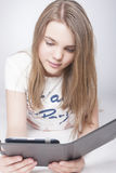 Portrait of Little Teenage Caucasian Girl With Tablet PC Royalty Free Stock Photo