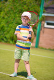Portrait of little tennis player Stock Image
