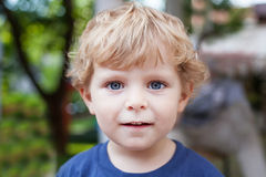 Portrait of little toddler boy with blond hairs royalty free stock photography