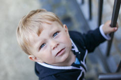 Portrait of little toddler boy on lake in summer Royalty Free Stock Image