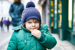 Portrait of little toddler boy walking through the city on cold Royalty Free Stock Photo