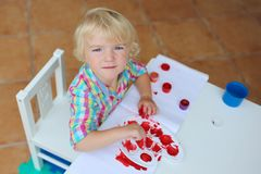 Portrait of little toddler girl painting with brush Royalty Free Stock Images