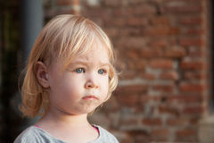 Portrait of little unhappy child girl Stock Images