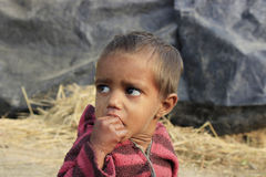 Portrait of a little vagabond kid. Homeless kid. Stock Photos