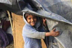 Portrait of a little vagabond kid. Homeless kid. Royalty Free Stock Photo