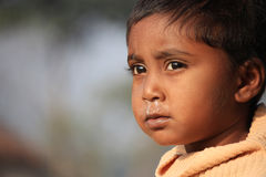 Portrait of a little vagabond kid. Homeless kid. Stock Images