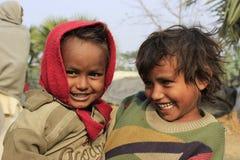 Portrait of little vagabond kids. Homeless kids. Royalty Free Stock Photo