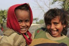 Portrait of little vagabond kids. Homeless kids. Stock Images