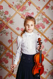 Portrait of the little violinist Stock Images