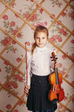 Portrait of the little violinist in Shabby chic decor Royalty Free Stock Images